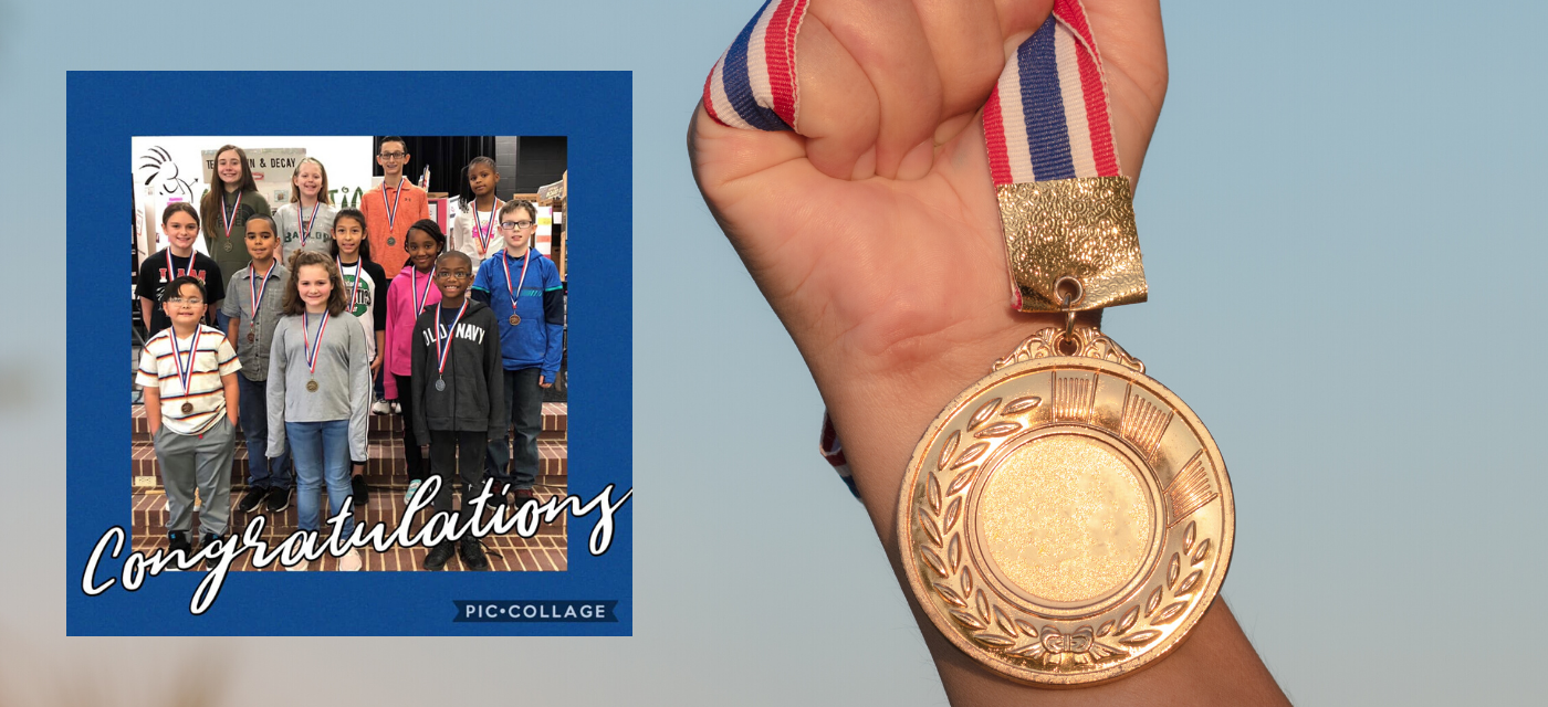 12 students wearing the medals they earned in the Science Fair