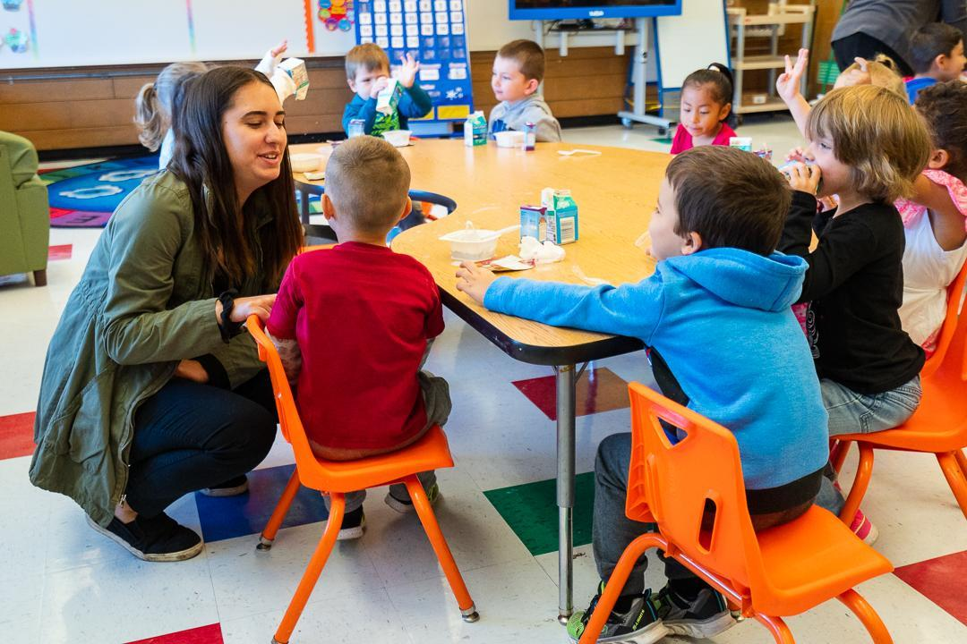 Teacher speaking with students