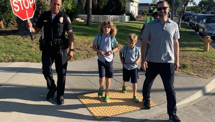 Neighborhood family walking to school