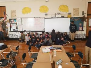 students sitting in the safe zone and one student standing up