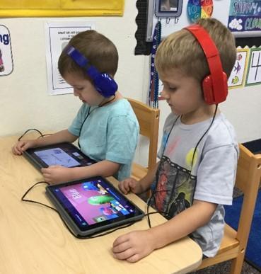preschool students working on their ipads