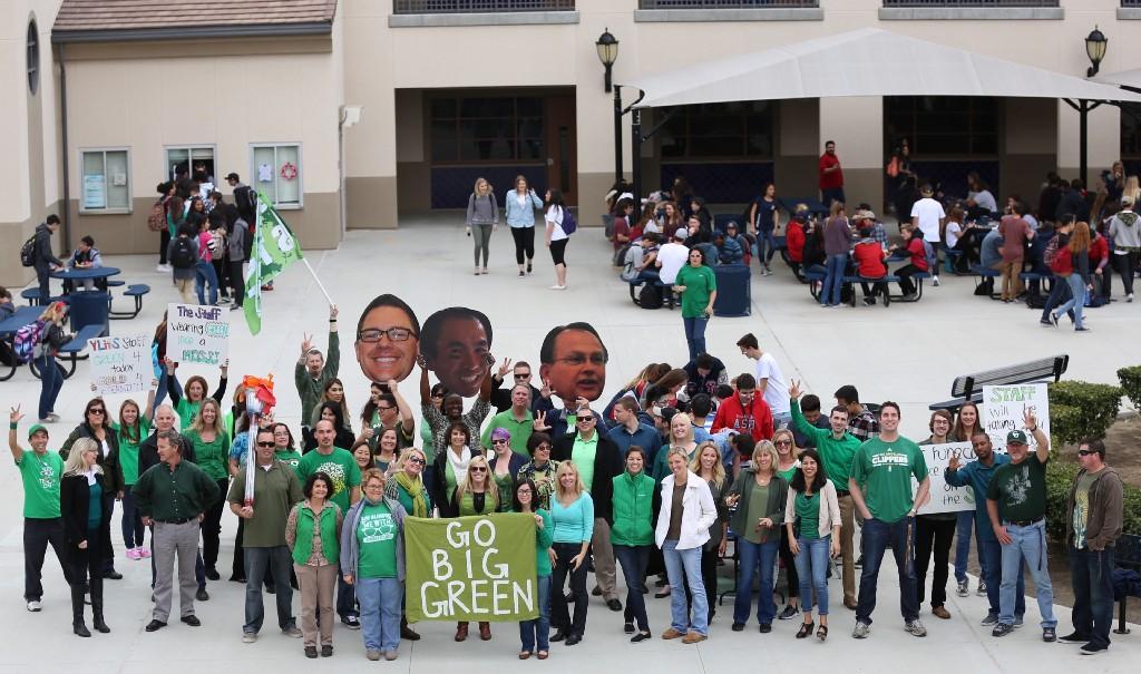 Staff members wearing green