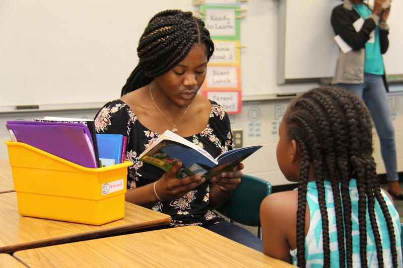 B-L High School senior Kiara Quattlebaum reads to a student at B-L Elementary School as part of the Big Panther, Little Panther program in Lexington School District Three.