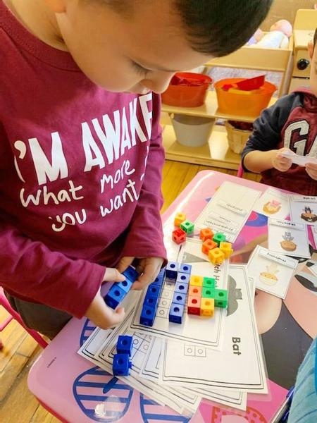 A Webster Extension student duplicates designs using Unifix cubes