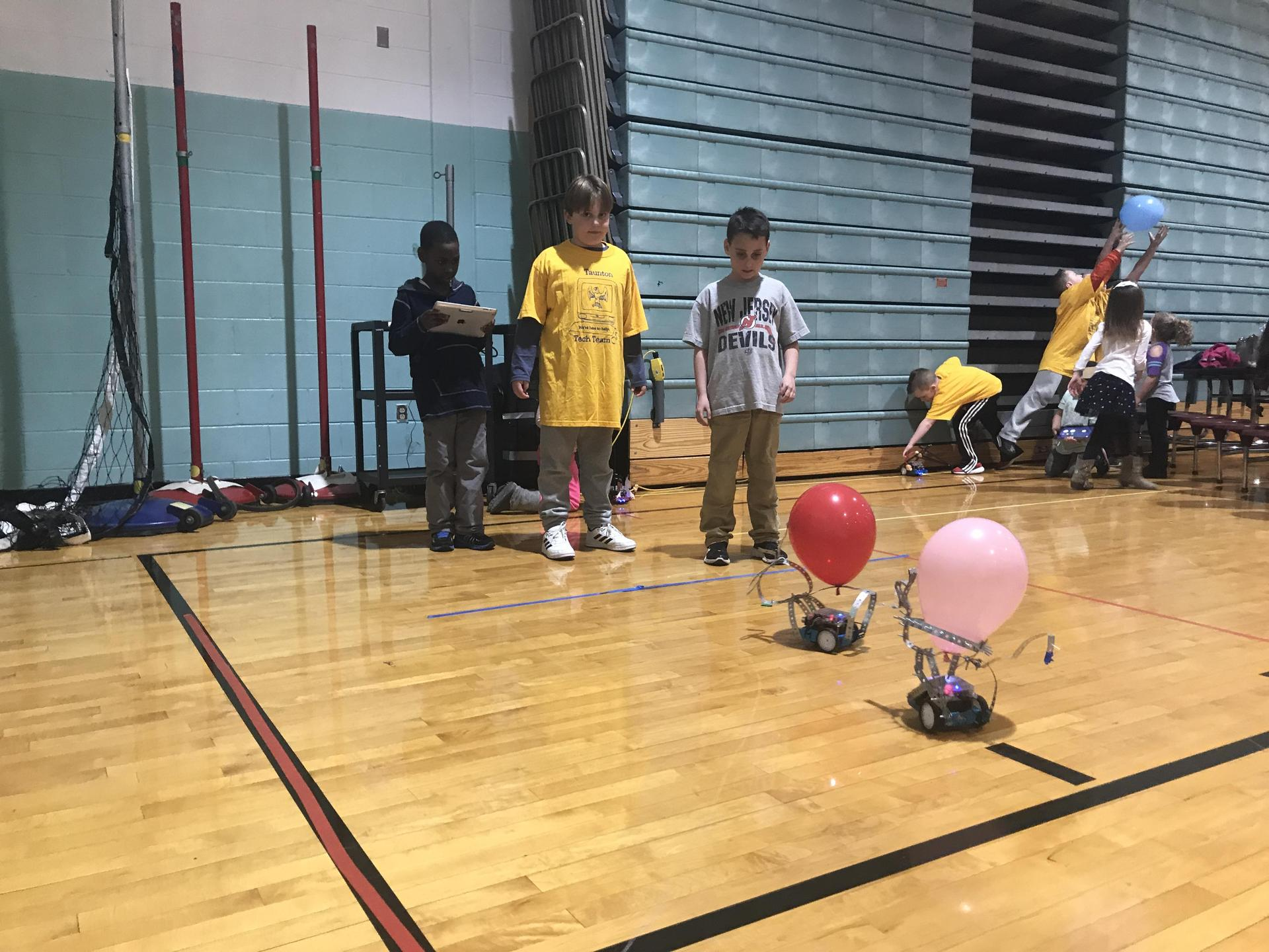 Students using MBots