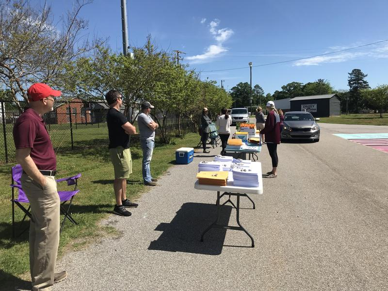 Clarkdale Take-Home Packet Pickup Line Photo