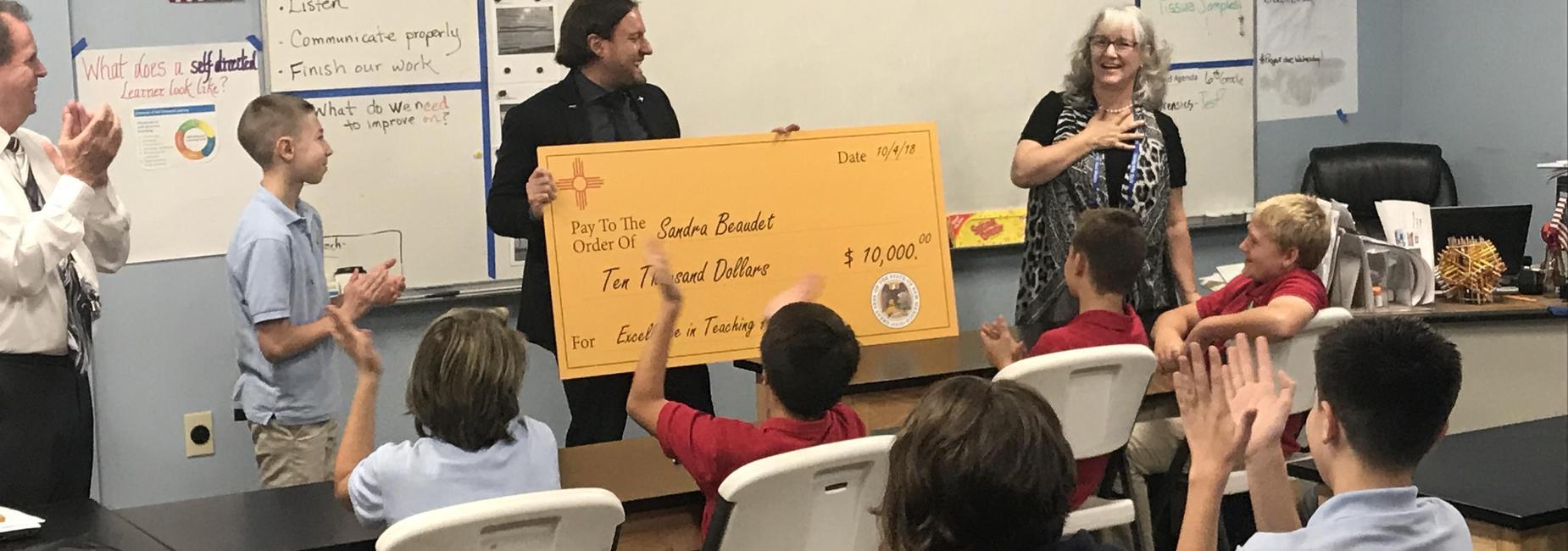 Teacher receiving recognition