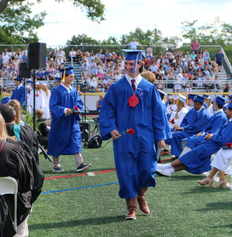 A Westfield High School Class of 2021 graduate is all smiles after receiving his diploma.