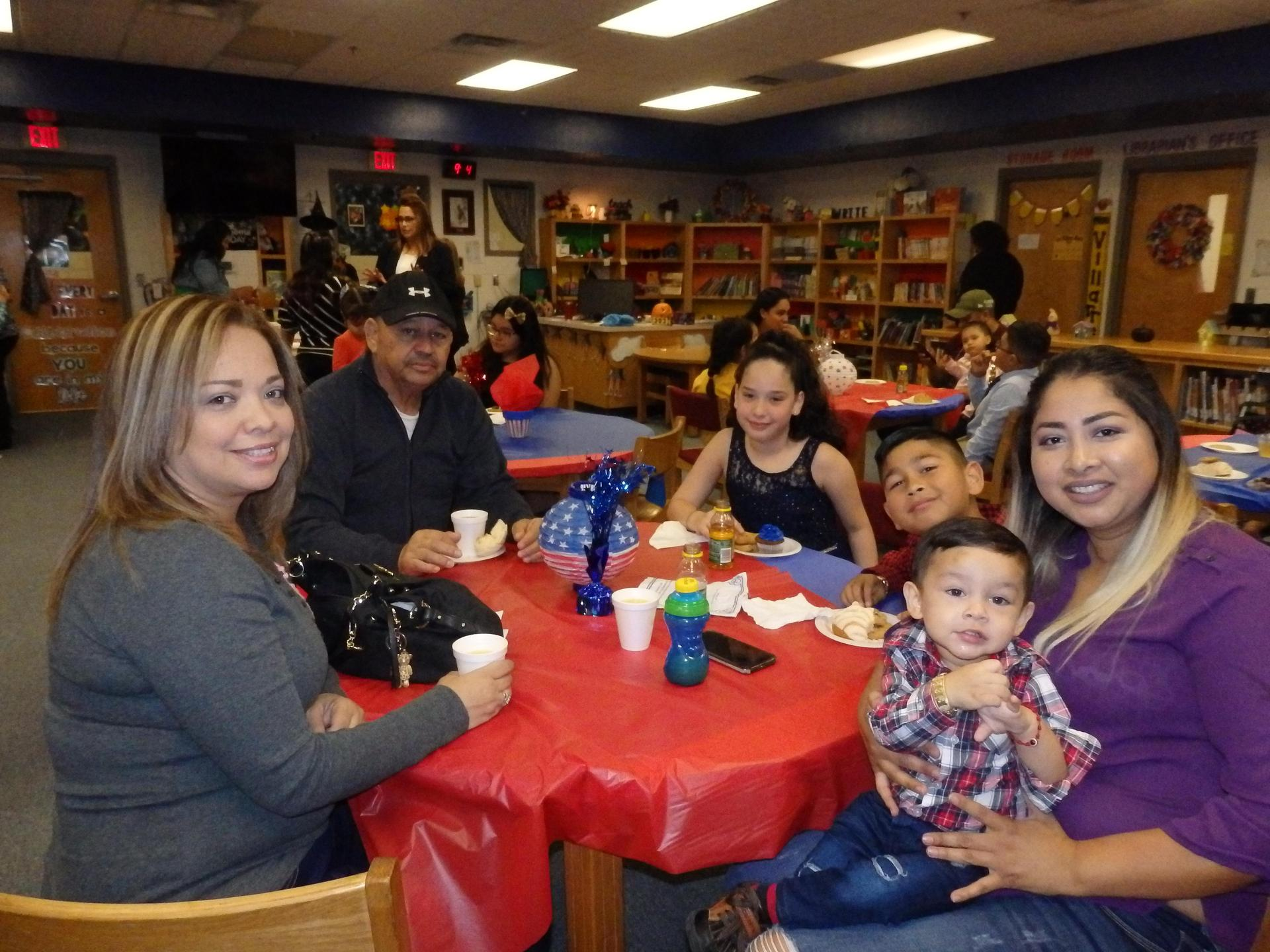 Student council parents and children celebrate in the library