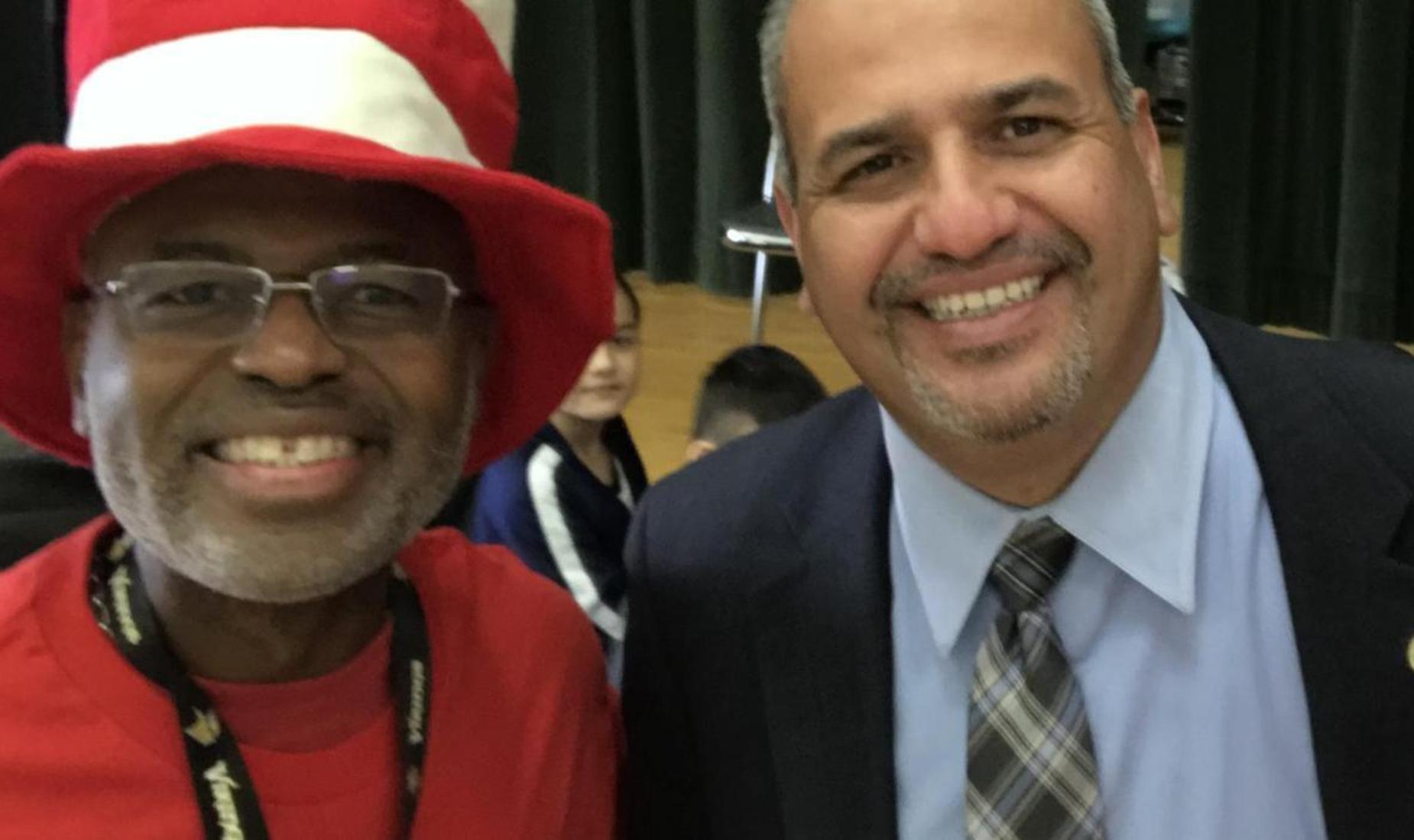 Superintendent Alvarado with a Read Across America volunteer