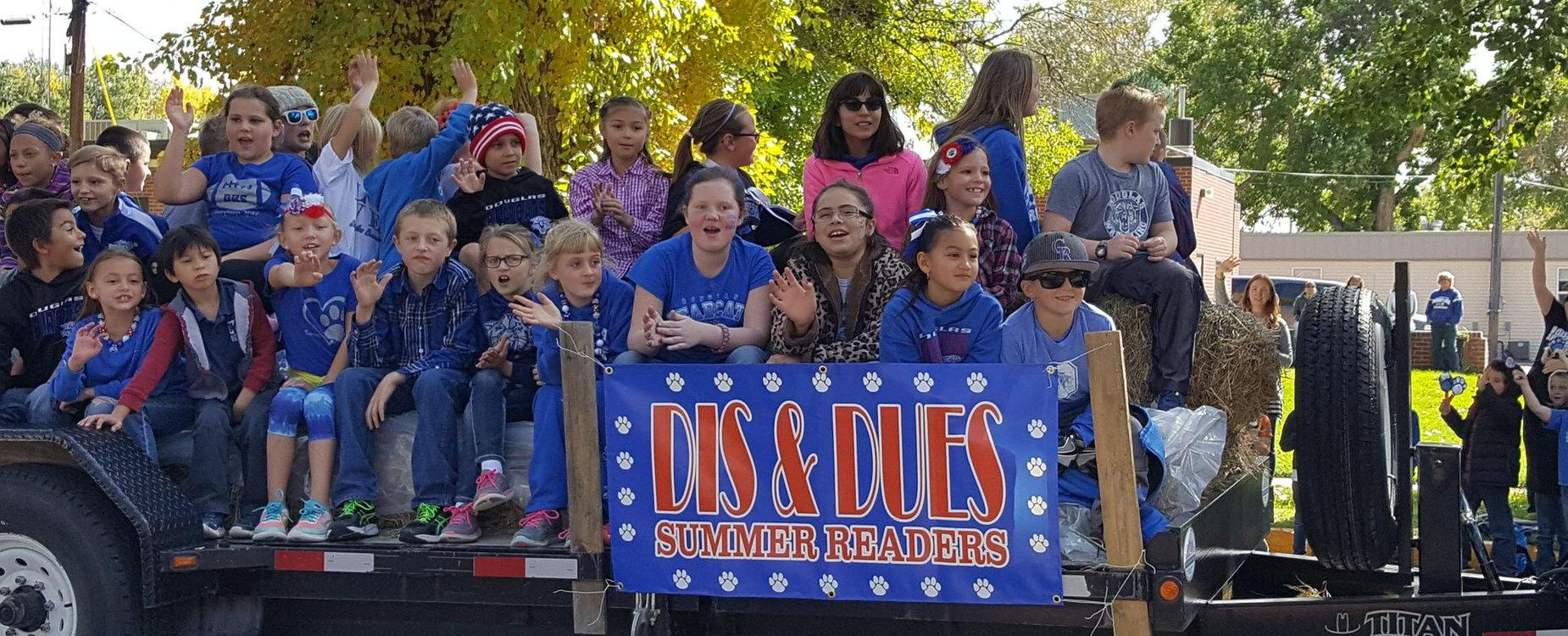 DIS Summer Readers on homecoming parade float
