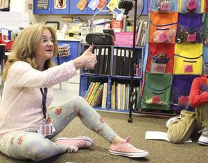 teacher giving a thumbs up in class