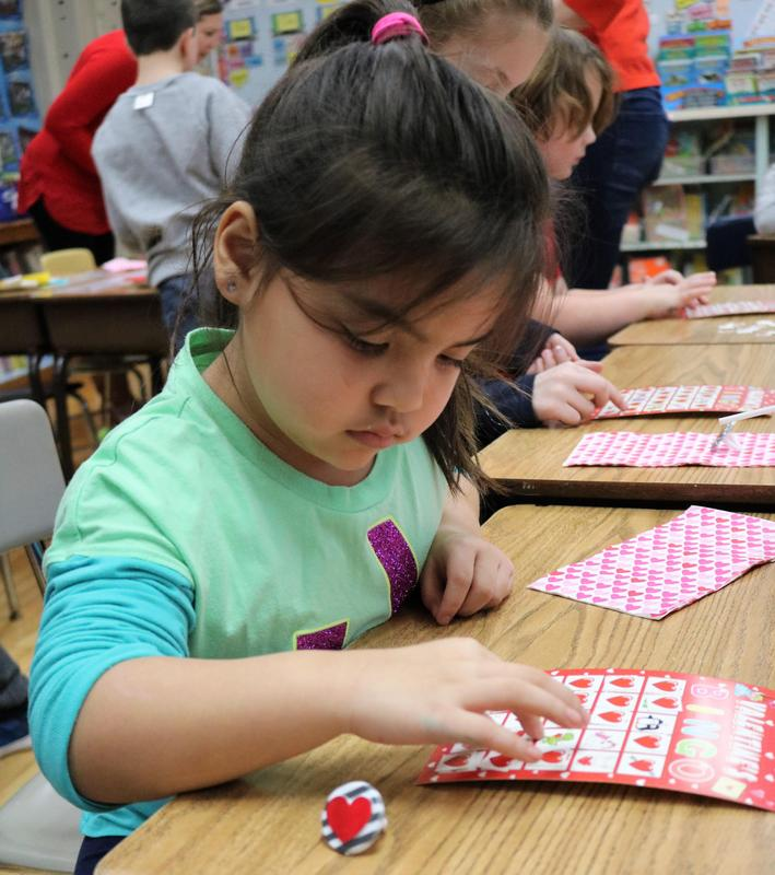 Photo of a McKinley student enjoying Valentine's Day activities.