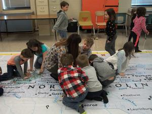 Students on the giant NC map.