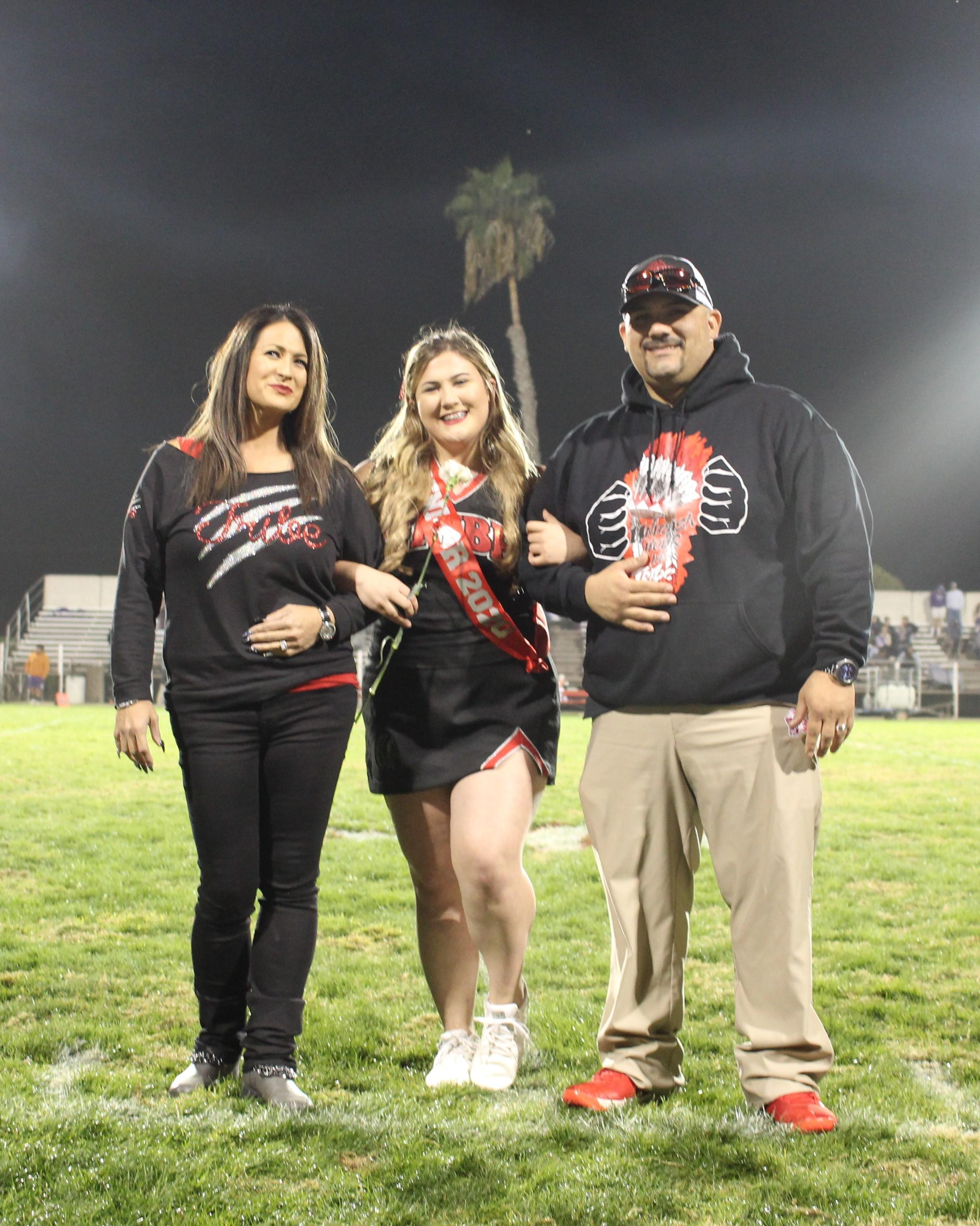 Senior cheerleader Jalyssa Escoto and her escorts.