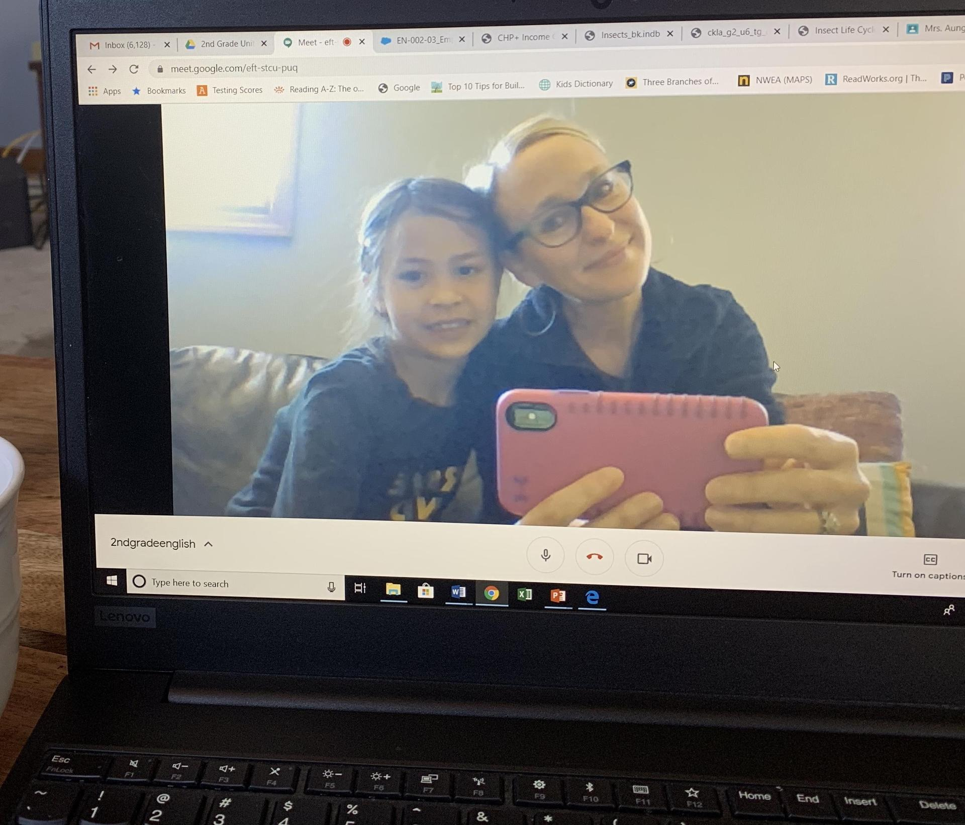 Parent and student pose on the webcam