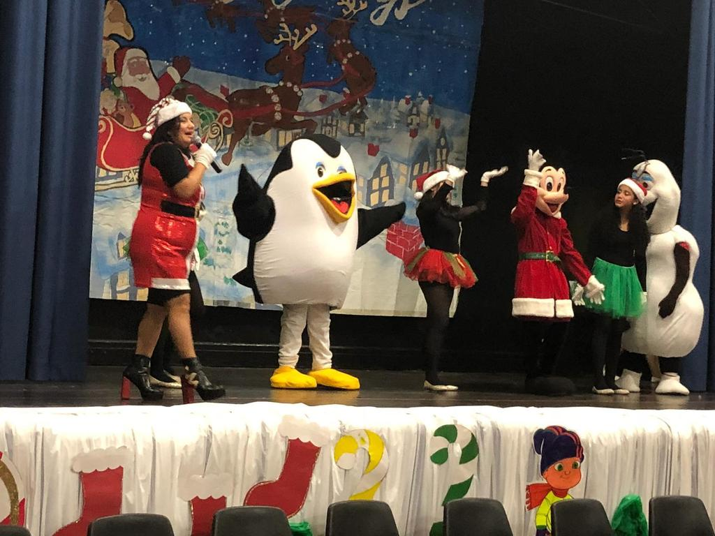 winter animals and young students dancing on stage