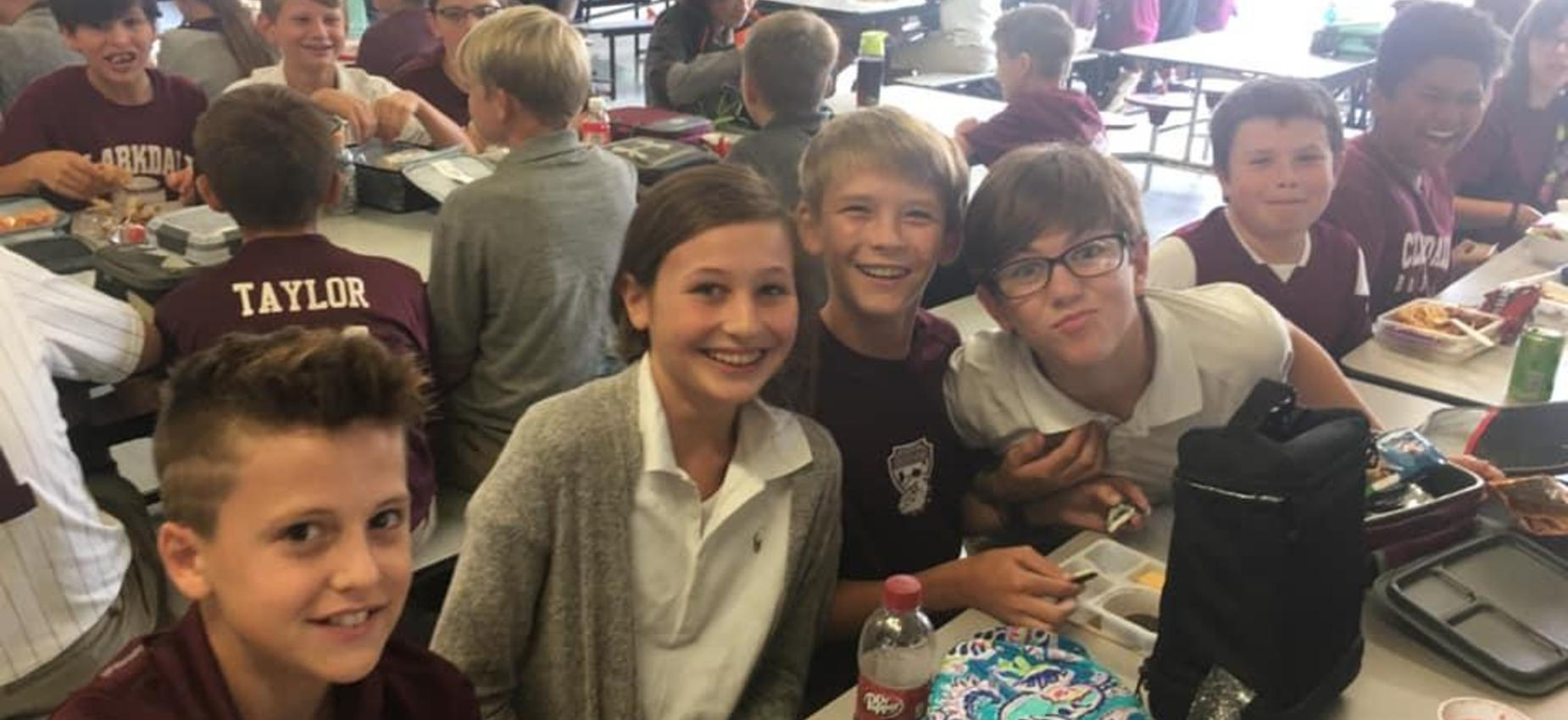 Students enjoy time with friends at lunch.