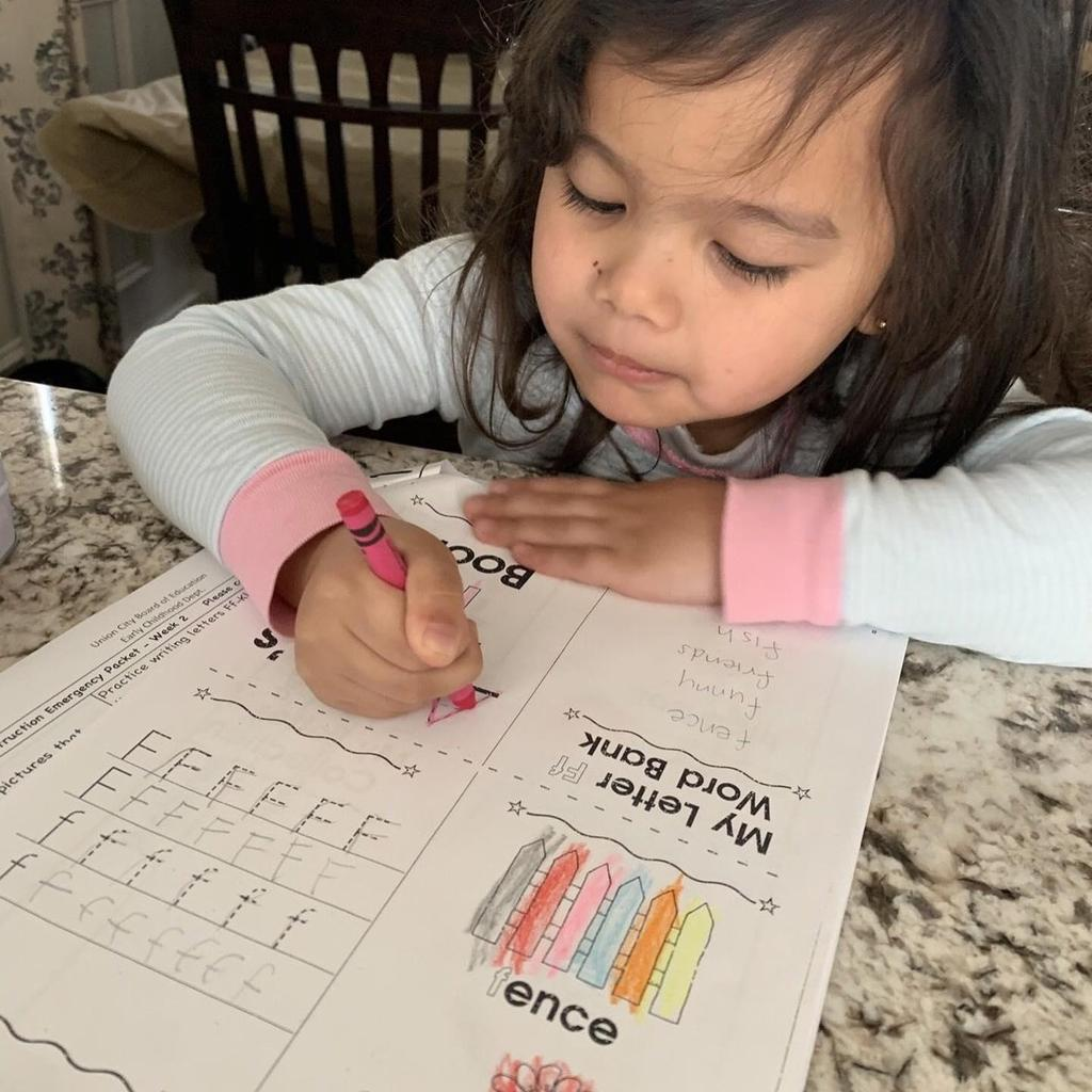 girl working on her F word bank activity sheet