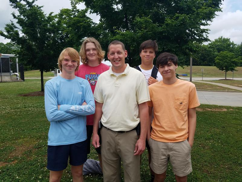 A picture of Joel Taylor and some DFC students