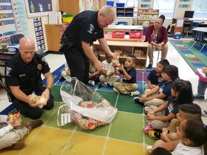 CMPD reads to students at J.W. Grier Elementary