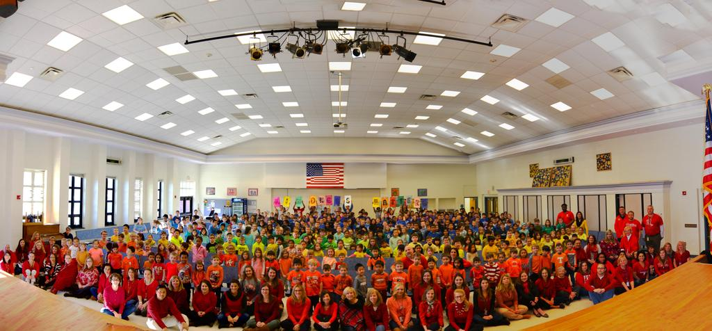 Stony Brook Elementary students and staff wear the colors of the rainbow for Kindness week.