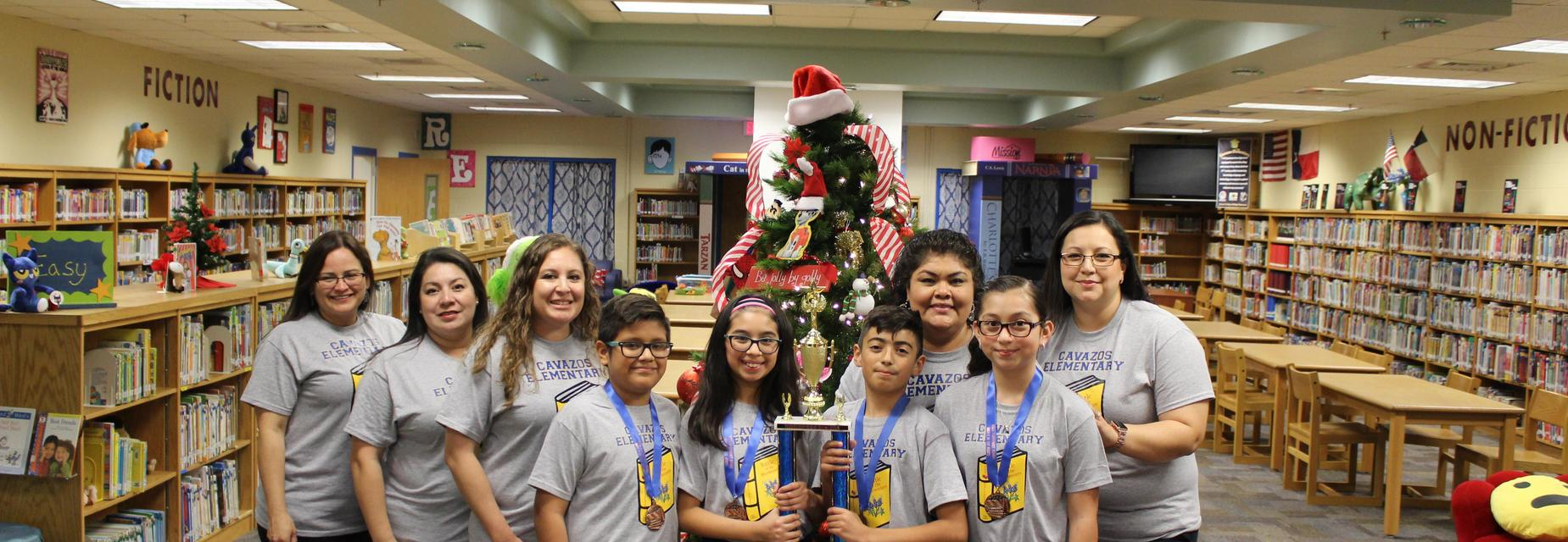 Bluebonnet team with trophy and staff members
