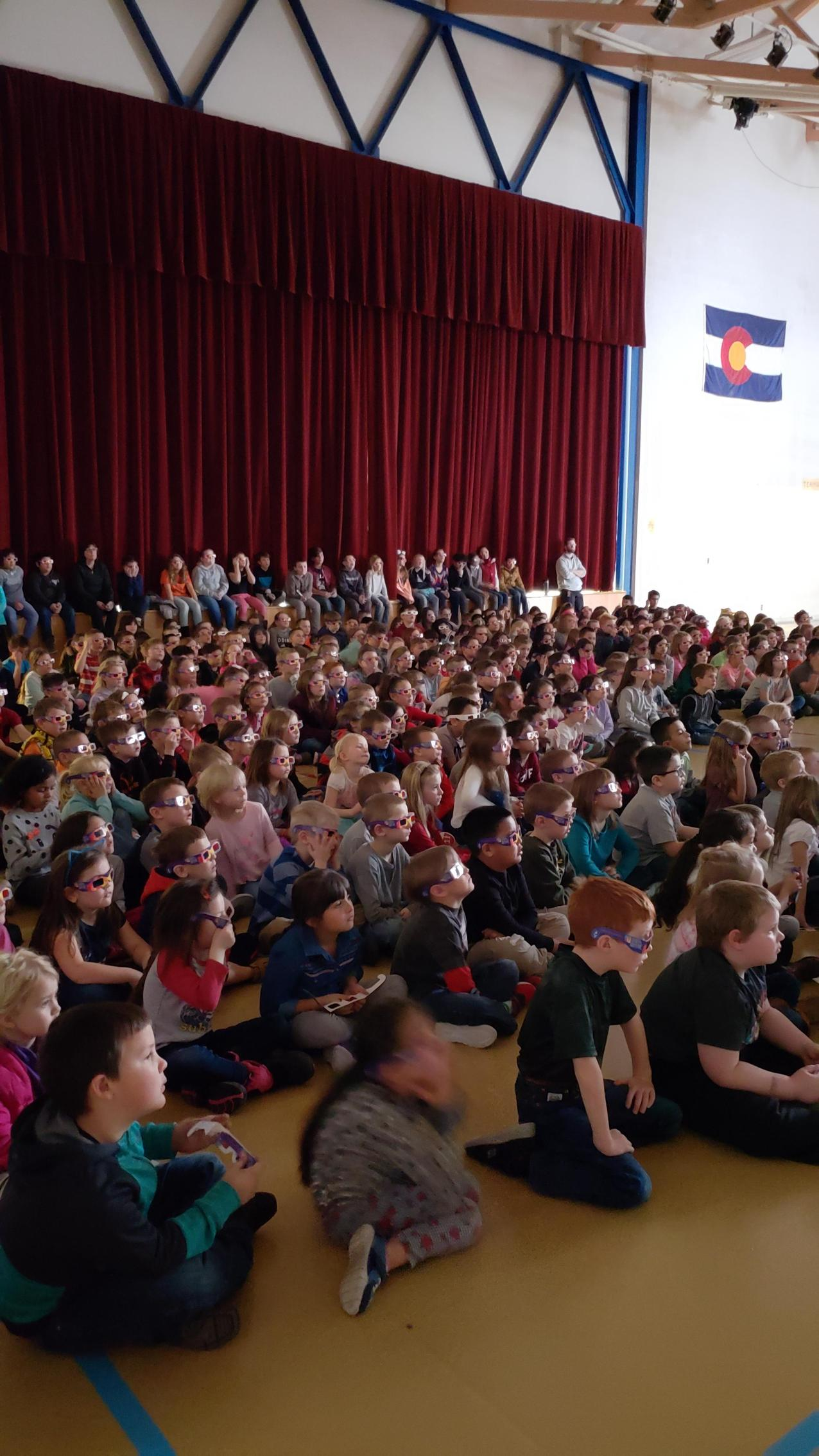 Students using 3D glasses in assembly for Kids Heart Challenve