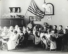 Image of young boys and girls sitting at tables working on crafts and activities.