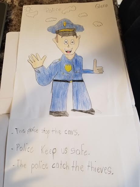 Police officer waving drawing and explanation