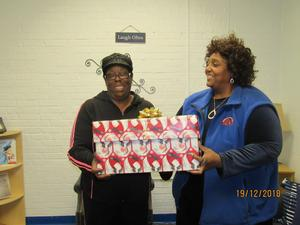 grandparent receives a gift from employee