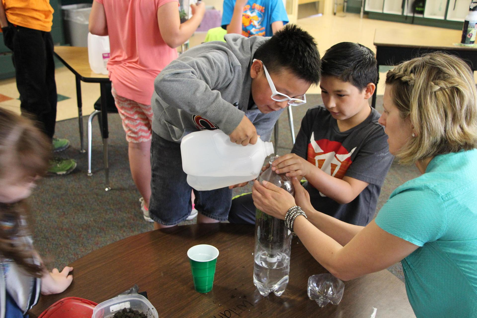 students measuring water