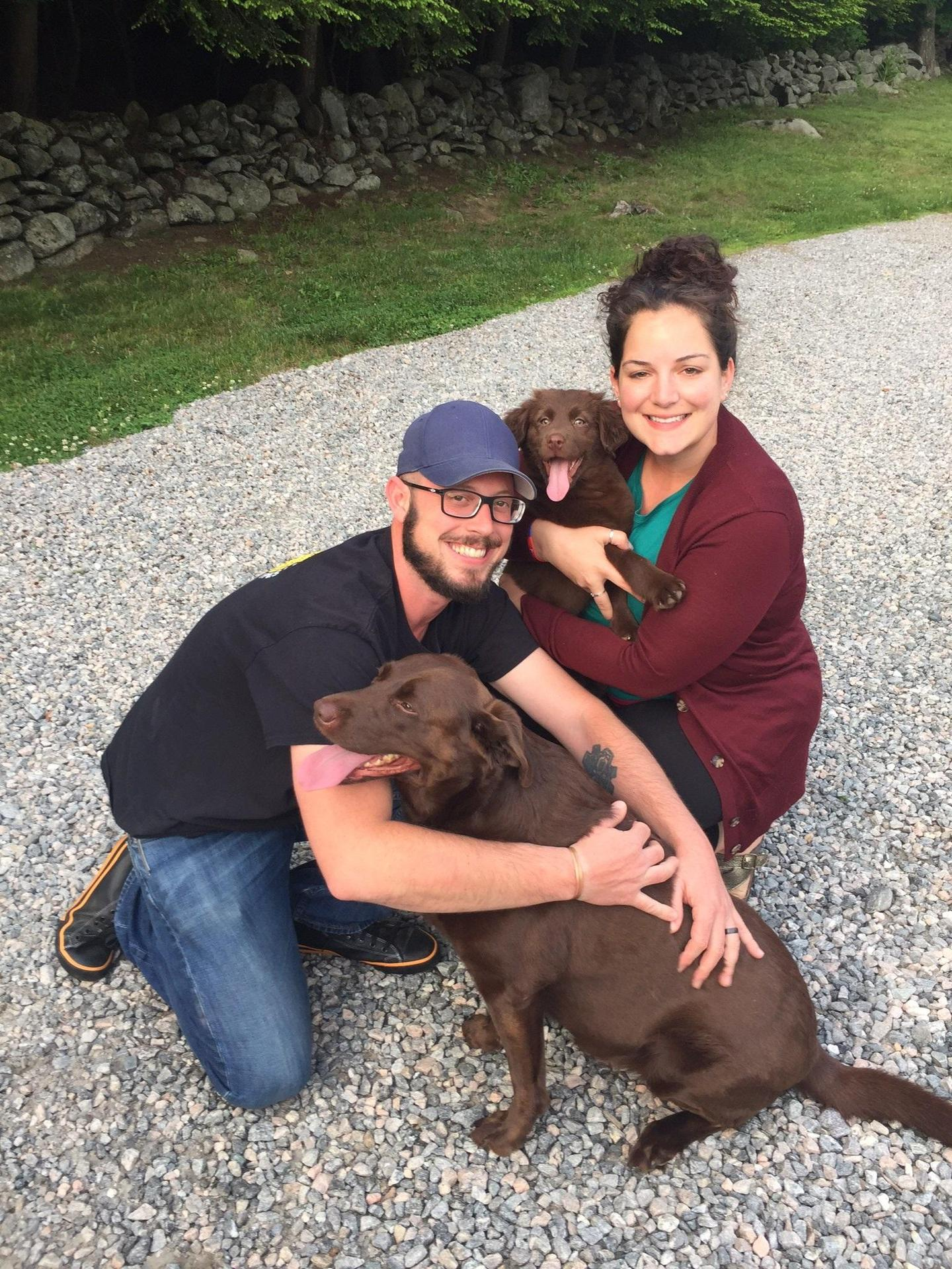 Man and woman and two chocolate labs