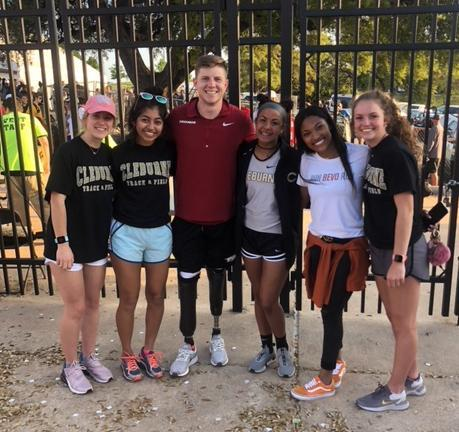 Cleburne track team members with Hunter Woodhall