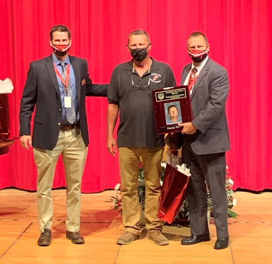Mr. Joe Penney, Mr. Danny Price and Superintendent Billy Smith present a plaque to Danny Price honoring him as Support Staff Member of the Year for 2020.