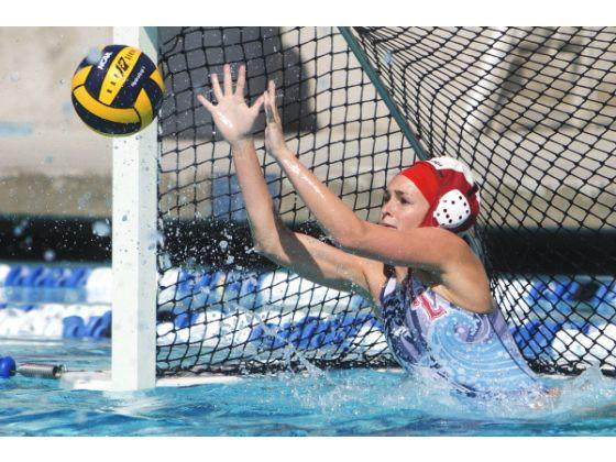 Women's Waterpolo CIF game, goalie blocking a shot