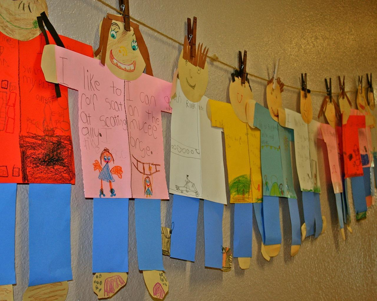 Cutout kids with different colored shirts