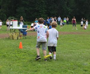 Two students at Washington School enjoy two-legged race during Field Day.