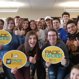 WVHS student with PACE signs