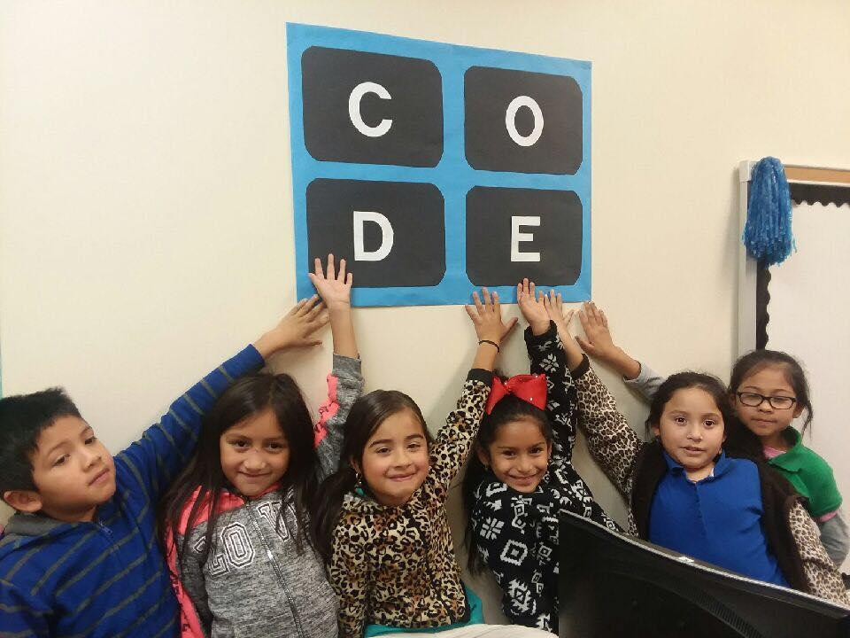 students posing with the word CODE during Computer Science Week
