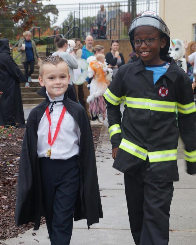 Cardinal Buddies walk together during the Halloween Parade.