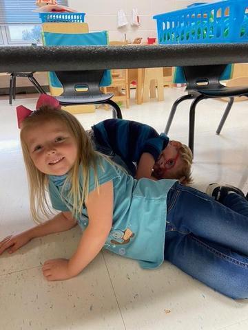 student under desk