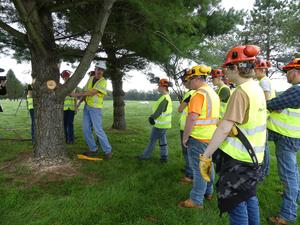 students learning from National Grid rep