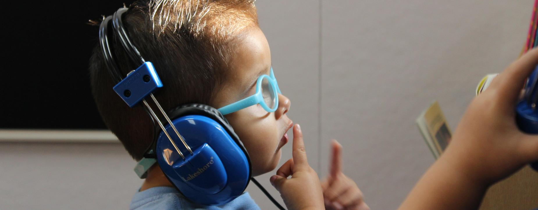 Boy with headset thinking