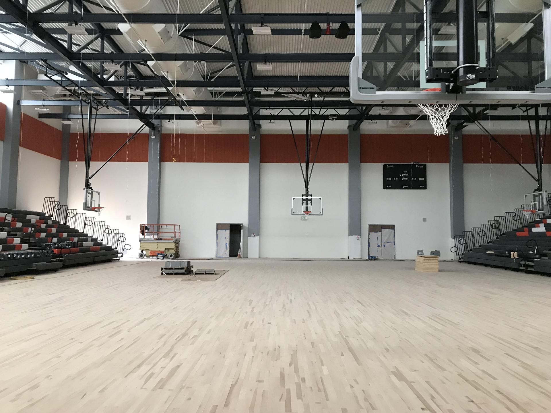 Interior photo of Castaic High School gym with bleachers and basketball hoops