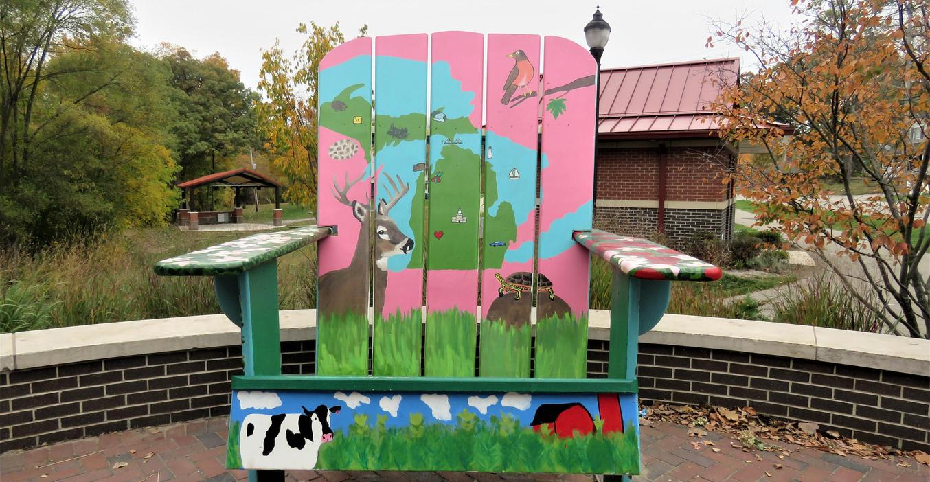 TKHS art students painted the big chair attracting visitors to Middleville.