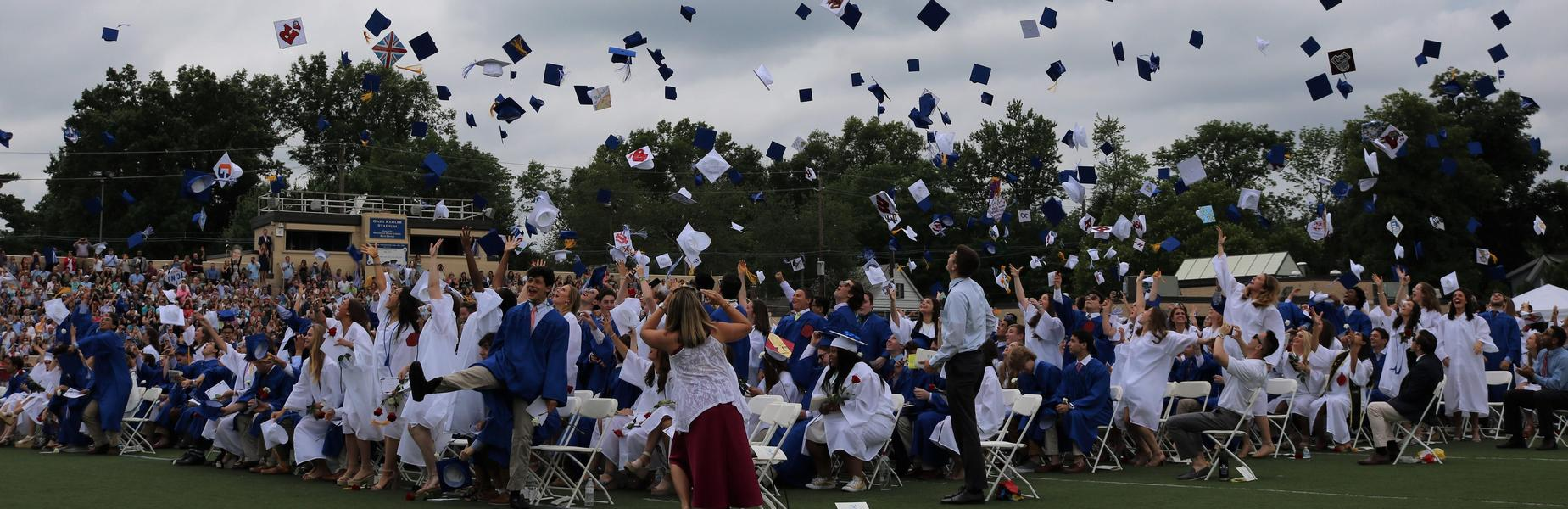 WHS graduates - Class of 2018 - toss caps into the air at commencement ceremony conclusion in June 2018.