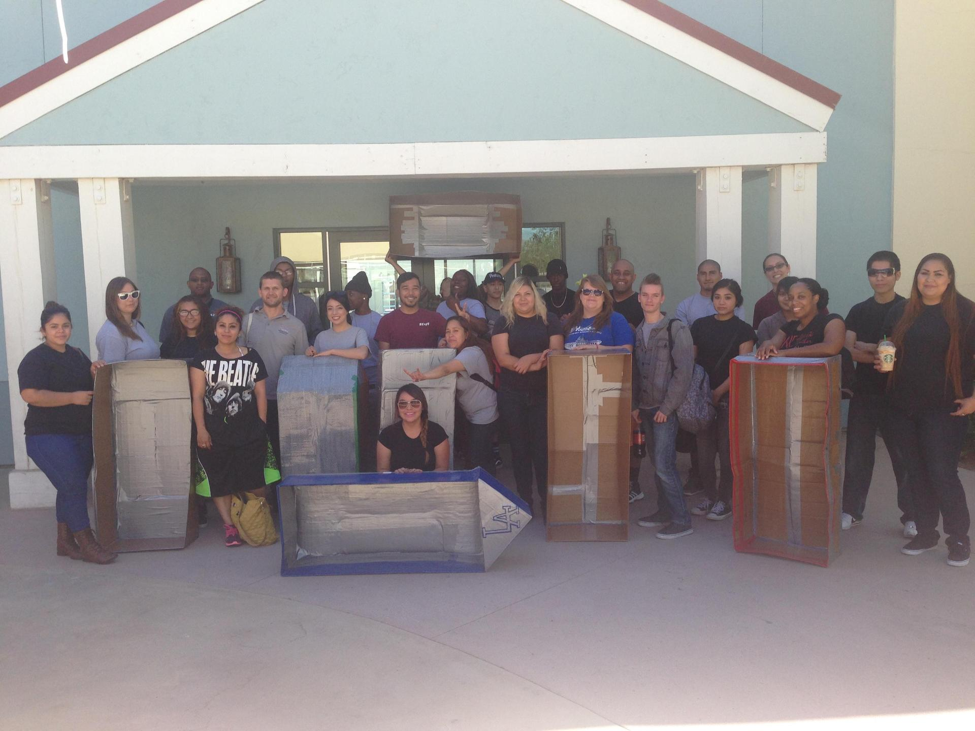 Palmdale students pose with their cardboard boats