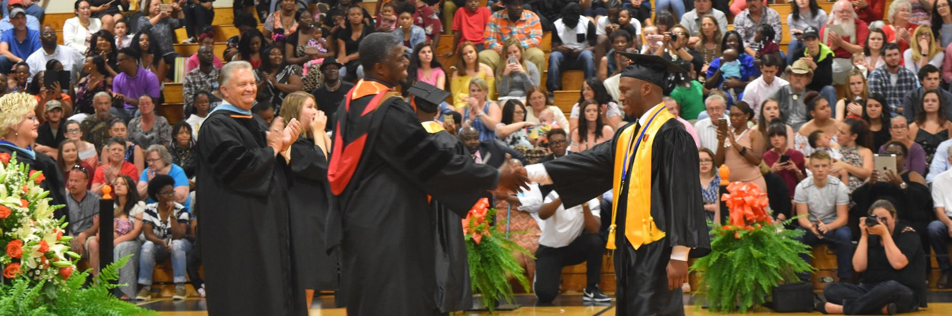 ghs student receiving diploma at graduation