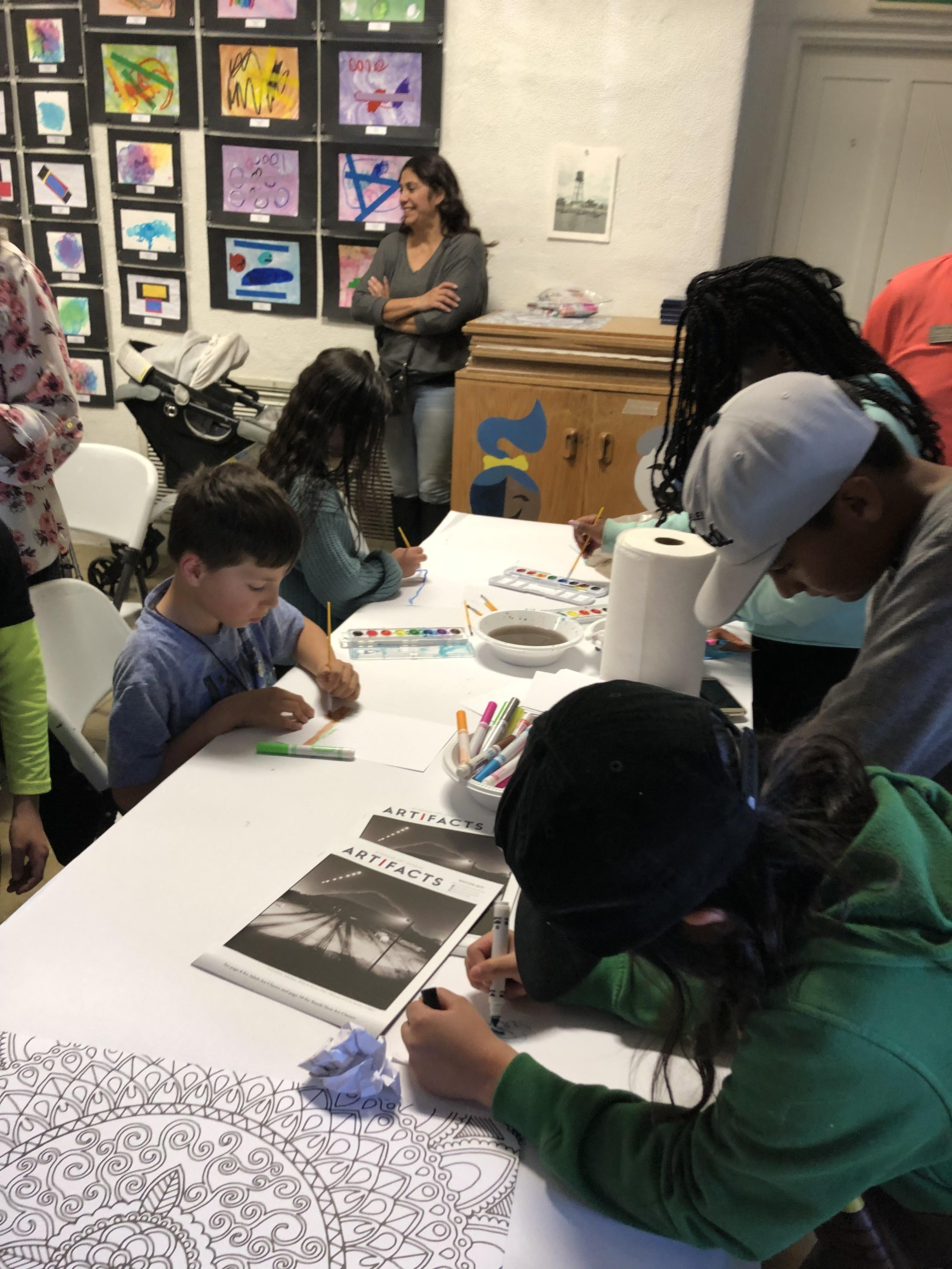 Students Painting at the Art Show